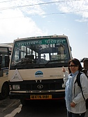 2008 india trip:Cannie in front of Bus to Dehra Dun.JPG